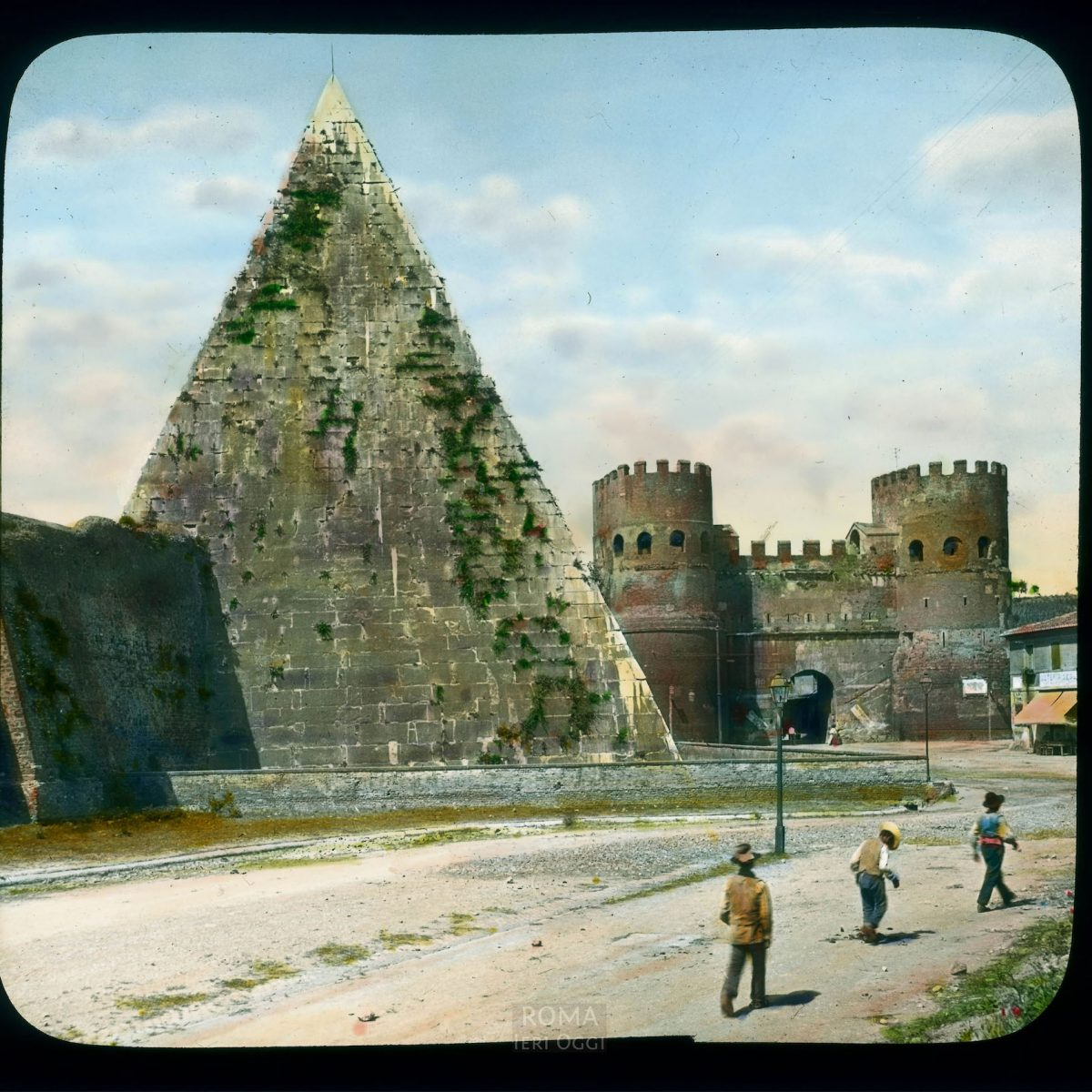 Rome. Pyramid of Caius Cestius: view with Porta San Paolo in the background View in tinted lantern slide, ca. 1919-1938. The pyramid dates from ca. 18-12 B.C.E. The gate dates from the 3rd century, with enlargements in the 6th century.
