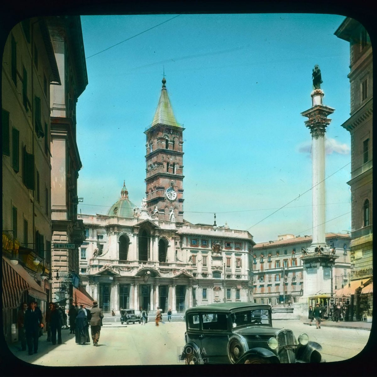 Rome. Piazza di Santa Maria Maggiore: view of the Marian Column by Maderno, and the basilica facade View in tinted lantern slide, ca. 1919-1938. The column dates from 1614, the facade from ca. 1743, the campanile from the 14th century.