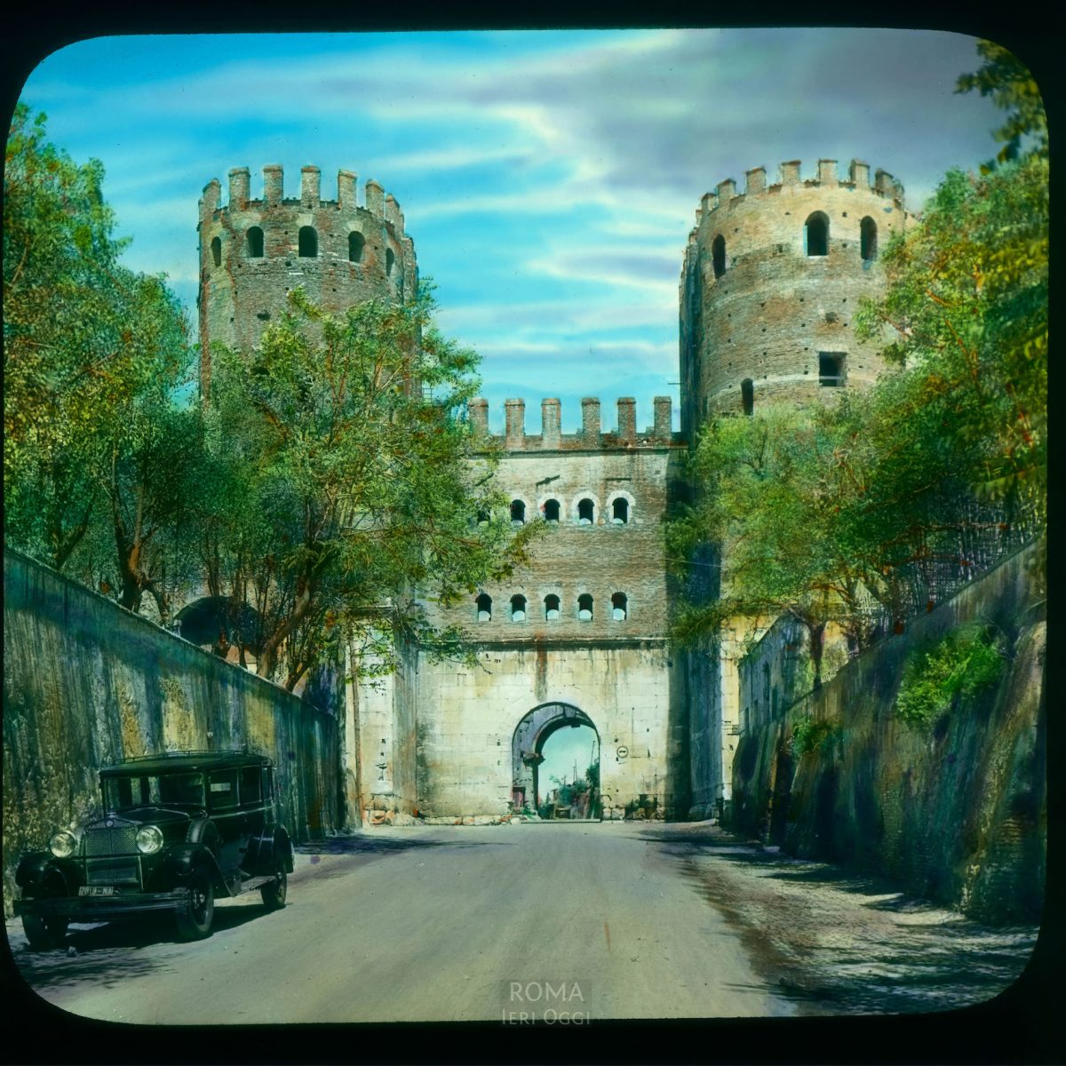 Rome. Porta San Sebastiano: view of south face, from the Appian Way (Via Appia) View in tinted lantern slide, ca. 1919-1938. The gate dates from ca. 271-275 C.E.