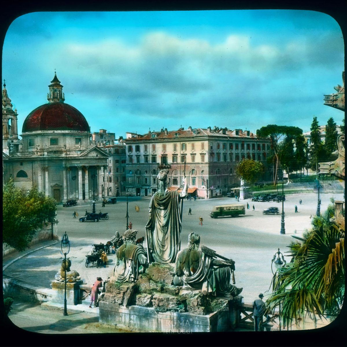 Rome. Piazza del Popolo: view towards Santa Maria dei Miracoli, over the back of the Neptune fountain View in tinted lantern slide, ca. 1919-1938. The church dates from the 17th century, the fountain from ca. 1823.