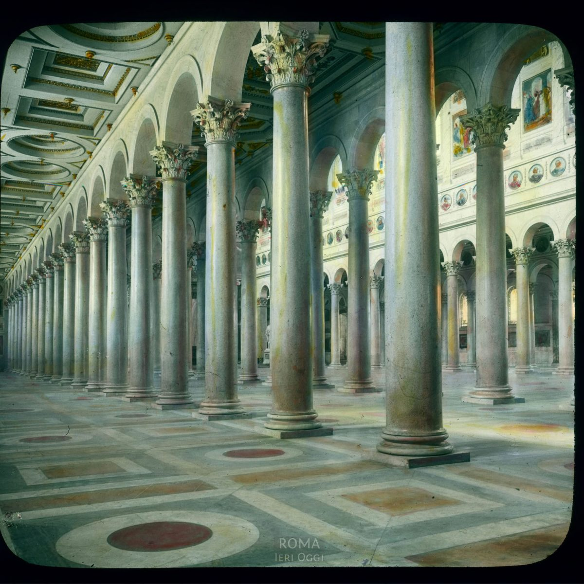 Rome. St. Paul's-Outside-the-Walls (Basilica di San Paolo fuori le Mura): interior view, 19th-century nave columns View in tinted lantern slide, ca. 1919-1938. The church dates from ca. 380, the cloister from the 13th century.