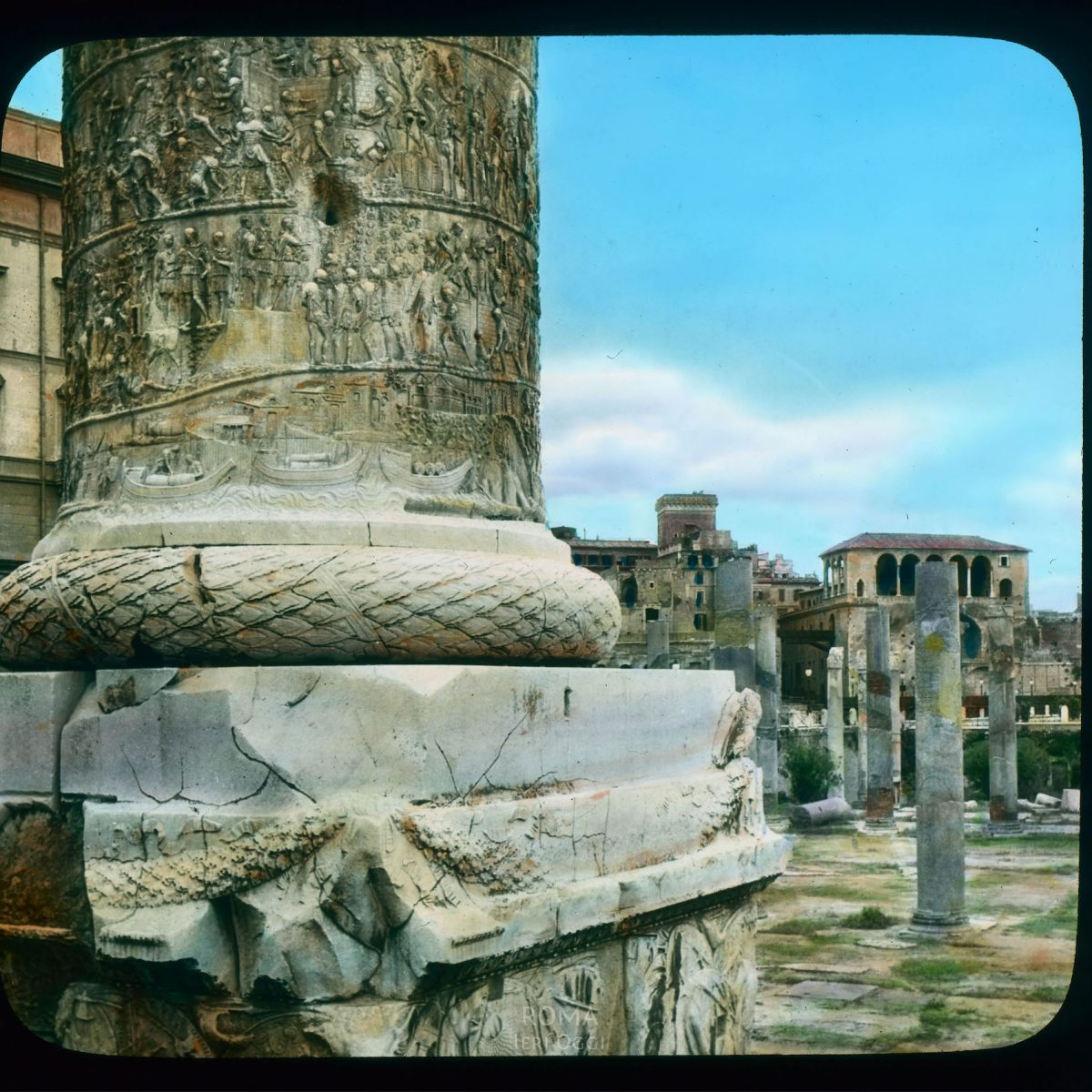 Rome. Trajan's Forum: Trajan's Column detail, base with spiral relief of Trajan's Dacian campaign View in tinted lantern slide, ca. 1919-1938. The column dates from 113 C.E.