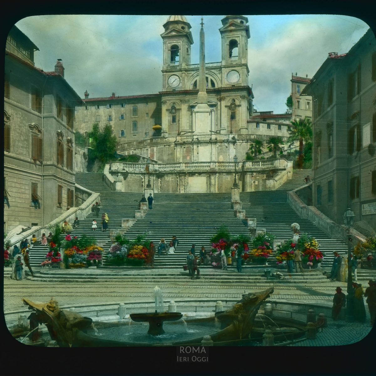 Rome. Spanish Steps (Scala di Spagna): view up from the Piazza di Spagna towards the church of Trinita dei Monti View in tinted lantern slide, ca. 1919-1938. The stairs were built 1721-1725. The church was built in the 16th century, with a facade by Carlo Maderno.