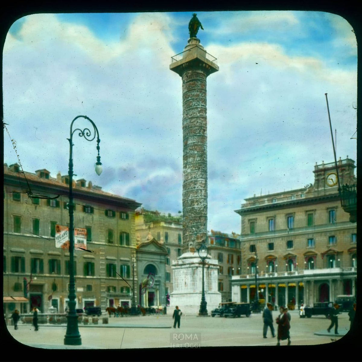 Rome. Piazza Colonna: view with Column of Marcus Aurelius View in tinted lantern slide, ca. 1919-1938. The column dates from ca. 193 C.E.