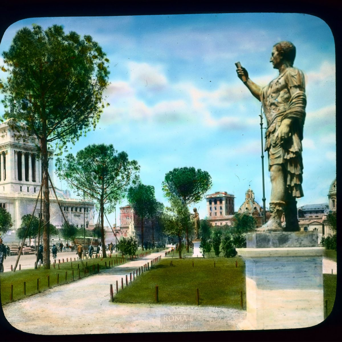 Rome. Via dei Fori Imperiali: view with bronze sculpture of Emperor Nerva View in tinted lantern slide, ca. 1931-1938