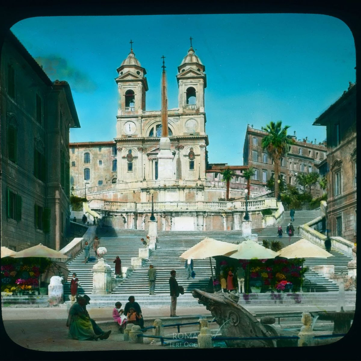Rome. Spanish Steps (Scala di Spagna): view up from the Piazza di Spagna towards the church of Santa Trinita? dei Monti View in tinted lantern slide, ca. 1919-1938. The stairs were built 1721-1725. The church was built in the 16th century, with a facade by Carlo Maderno.