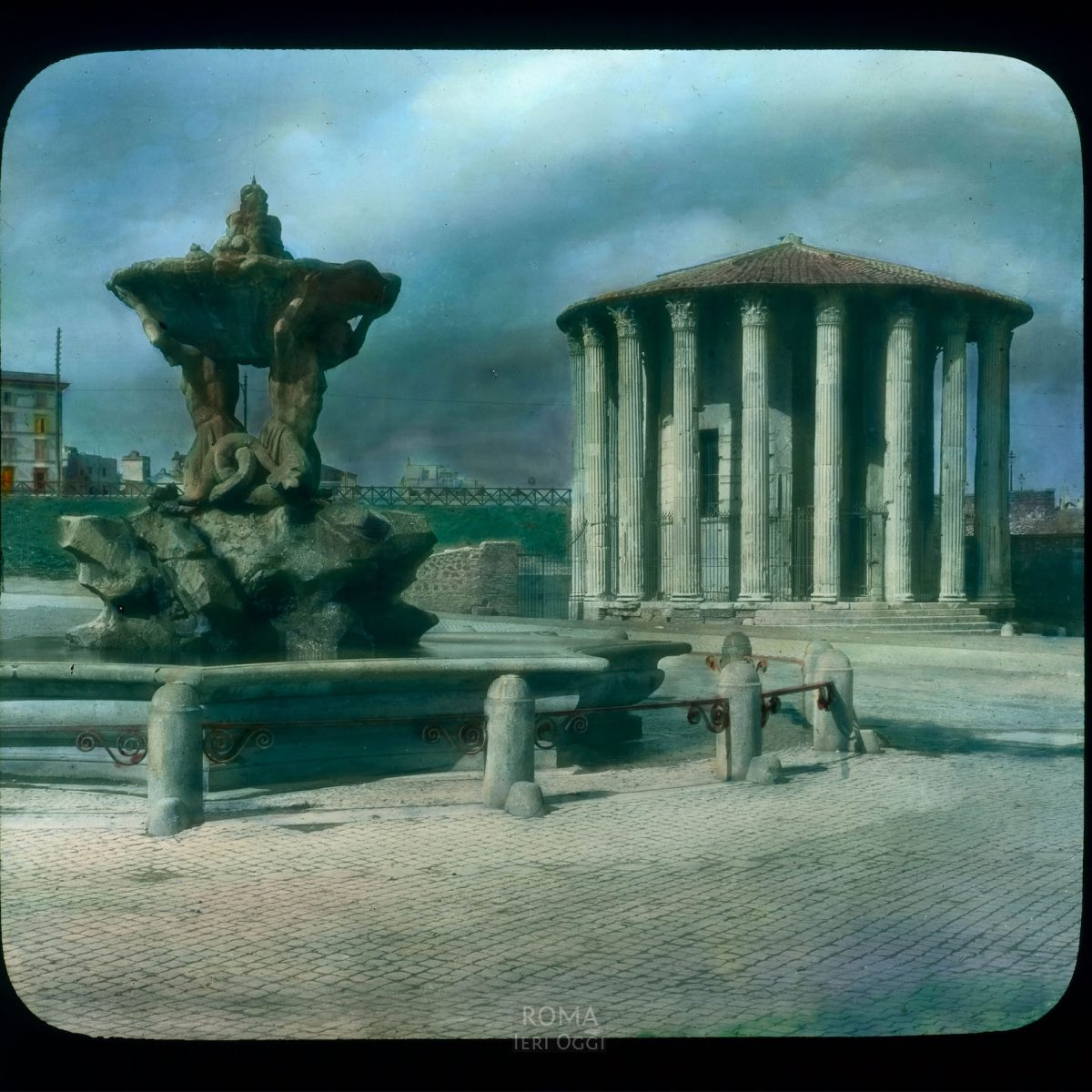 Rome. Temple of Hercules Victor (or Temple of Vesta) in the Forum Boarium: view with the Tritones Fountain View in tinted lantern slide, ca. 1919-1938. The temple dates from ca. 120 B.C.E.