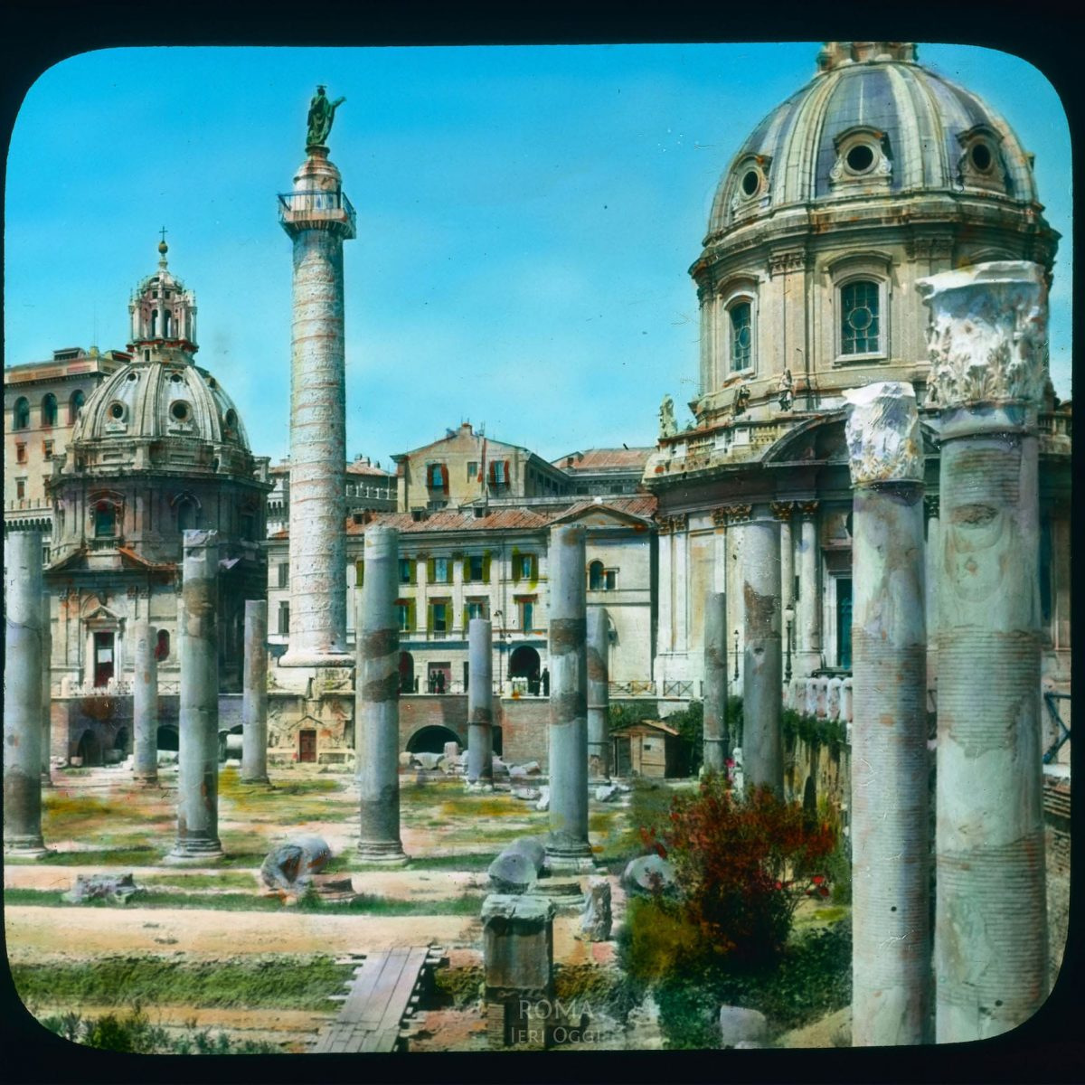Rome. Trajan's Forum: Trajan's Column and two churches, Santa Maria di Loreto and Santissimo Nome di Maria View in tinted lantern slide, ca. 1919-1938. The column dates from 113 C.E., Santa Maria di Loreto from the 16th century, and Santissimo Nome di Maria, by Antoine Derize, from 1736-1741.