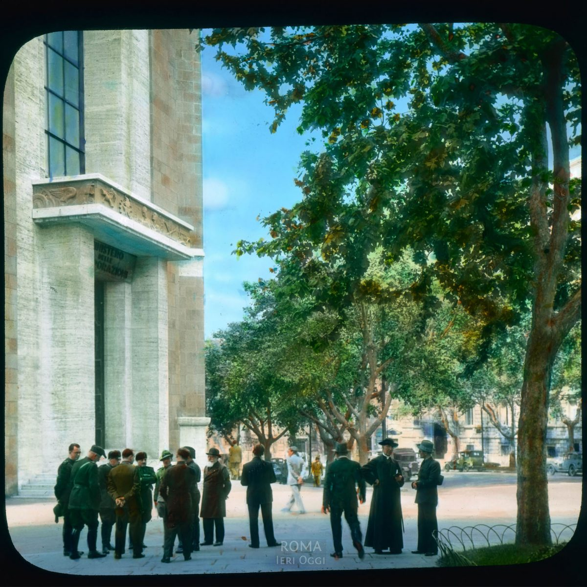 Rome. Via Vittorio Veneto: office building with a crowd of men standing outside View in tinted lantern slide, ca. 1931-1938