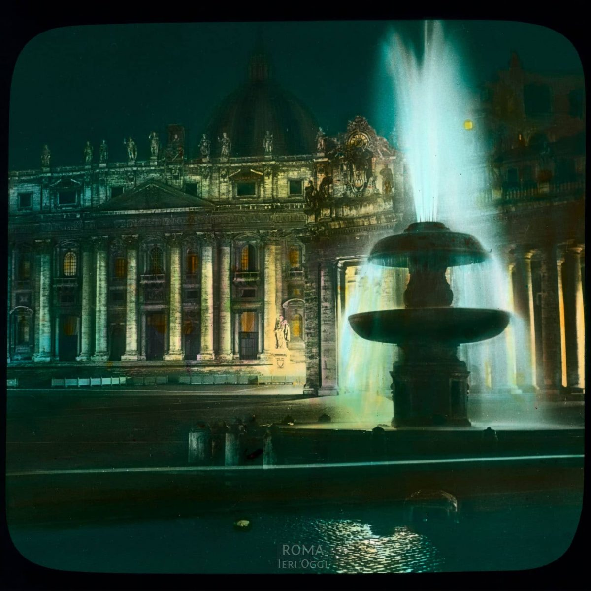 Vatican City. St. Peter's Basilica: facade on Piazza San Pietro, at night, with fountain View in tinted lantern slide, ca. 1919-1938. The basilica dates from ca. 1506-1626.