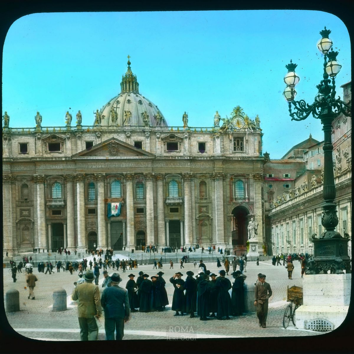 Vatican City. St. Peter's Basilica: facade on Piazza San Pietro View in tinted lantern slide, ca. 1919-1938. The basilica dates from ca. 1506-1626.