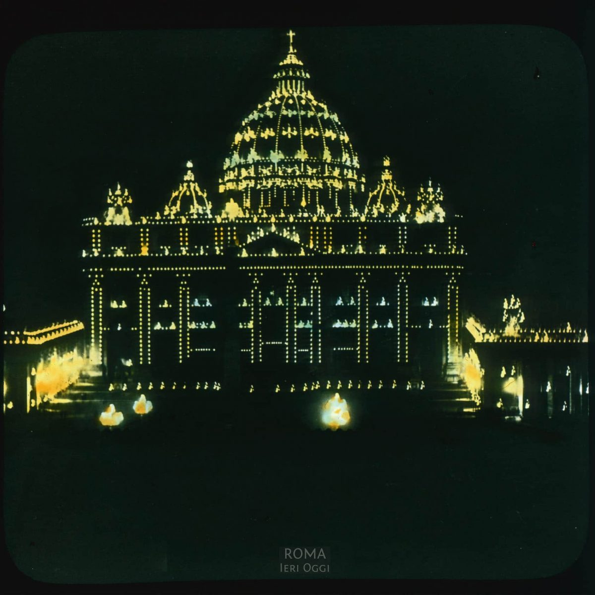 Vatican City. St. Peter's Basilica: facade on Piazza San Pietro, at night, with lights View in tinted lantern slide, ca. 1919-1938. The basilica dates from ca. 1506-1626.