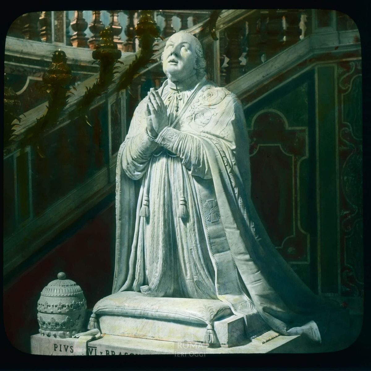 """Vatican City. Vatican Grottoes: Canova's """"Tomb of Pope Pius VI (Monument to Pius VI)"""", detail, figure of pope View in tinted lantern slide, ca. 1919-1938. The marble monument dates from 1817-1822."""