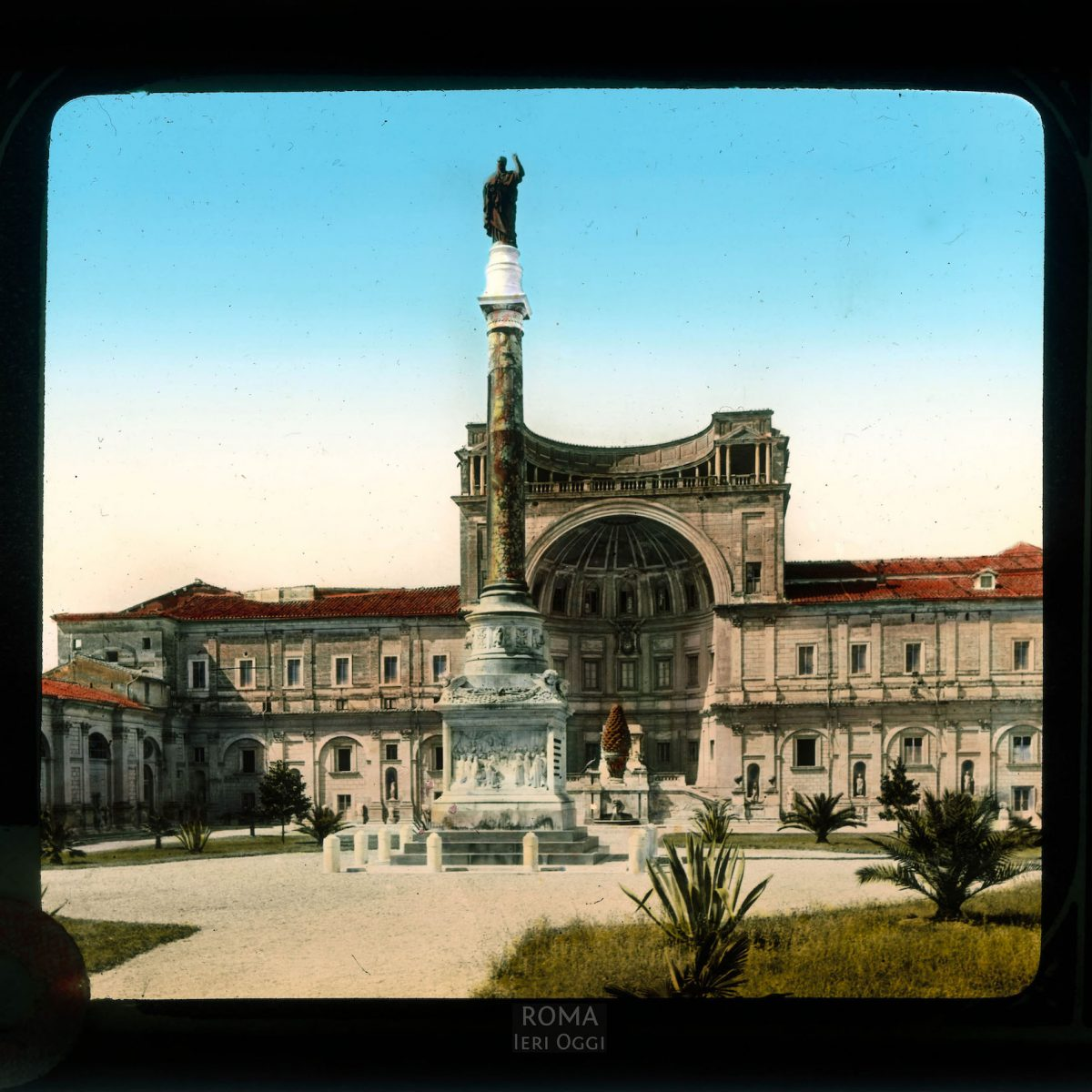 Vatican City. Vatican Museums, Cortile della Pigna: view of column, pine cone, niche of the Vatican Museums View in tinted lantern slide, ca. 1919-1938. The building dates from 1506-1514 and 1562-65; the column was erected in 1886.